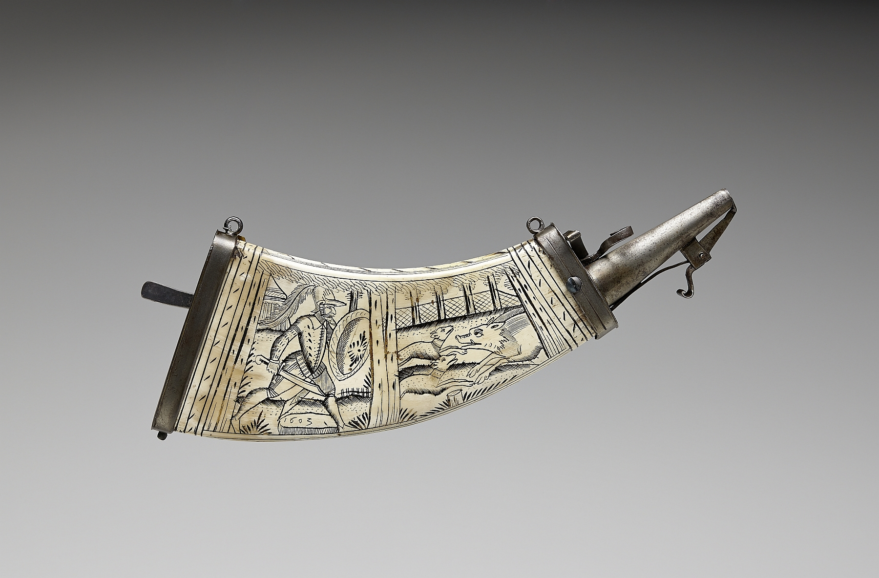 "Gunpowder horn with engraving: ""Hunter with shield and hunting trousse with two dogs on boar hunt"", 1603, pressed cow horn, metal, inv. no. WA 38"