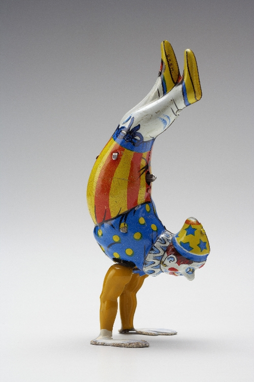Clown doing a handstand, 1950s, tin, inv. no. F 2103 a,b